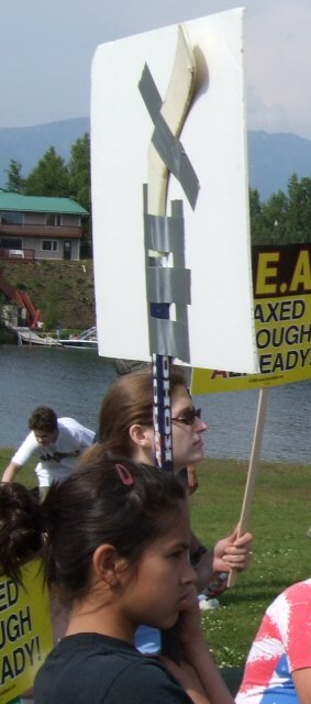 What was more fun was the construction of her sign, nothing says Alaska Snowbilly like a protest sign made from a hockey stick and duct tape.